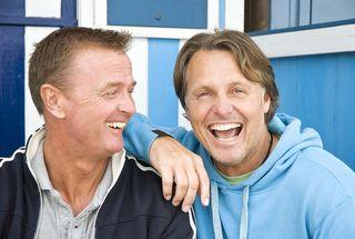 Bigstock-happy-smiling-gay-couple-7146773